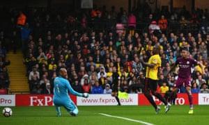 Gabriel Jesus scores his side's third goal past the Watford goalkeeper Heurelho Gomes.