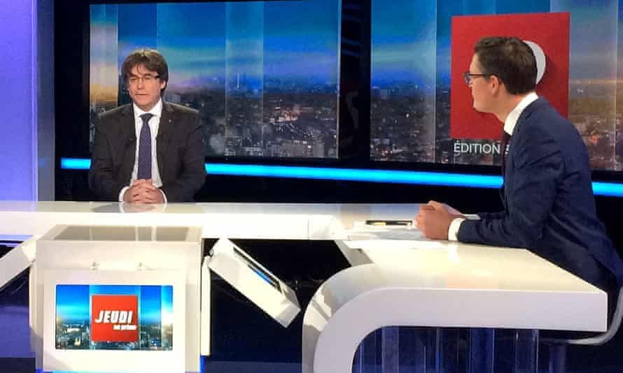 Catalan President Carles Puigdemont is interviewed on TV in Brussels.