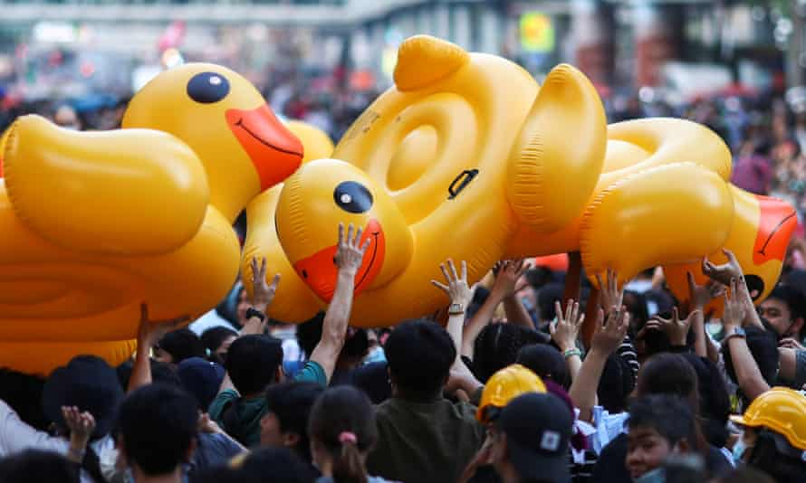 Demonstrators carry inflatable ducks during a rally in Bangkok on Wednesday