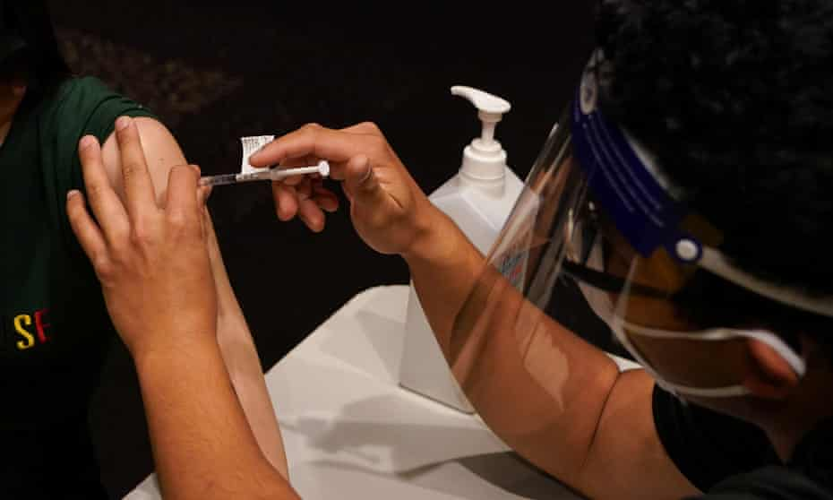 A patient receives a Covid vaccine at the Bankstown Sports Club in Sydney, Australia