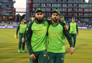 Imran Tahir and JP Duminy of South Africa leave the field for the final time.
