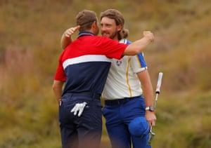 Team Europe's Tommy Fleetwood hugs Team USA's Jordan Spieth on the 18th green.