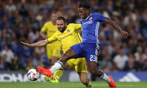 Bristol's Peter Hartley and Chelsea's Michy Batshuayi battle for possession during an August League Cup tie.