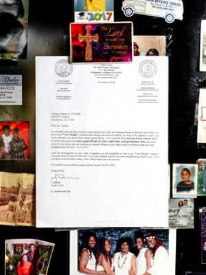 A letter hangs on Alfonzo Tucker's refrigerator stating that his right to vote has been revoked.