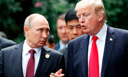 Donald Trump and Vladimir Putin talk during the Asia-Pacific Economic Cooperation leaders' summit in the central Vietnamese city of Danang last year.