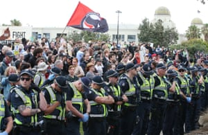 Police keep rival activists apart on the St Kilda foreshore.