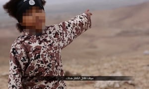 Screengrab from a video purporting to be Isis showing a young boy making threats to kill