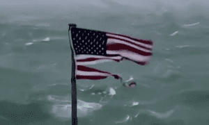 American Flag at Frying Pan Island tattering in hurricane force winds