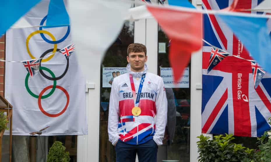Matty Lee with his gold medal in his parents' garden in Leeds.