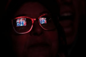 Des Moines, Iowa A supporter watches Donald Trump's election campaign rally on a large screen outside the venue