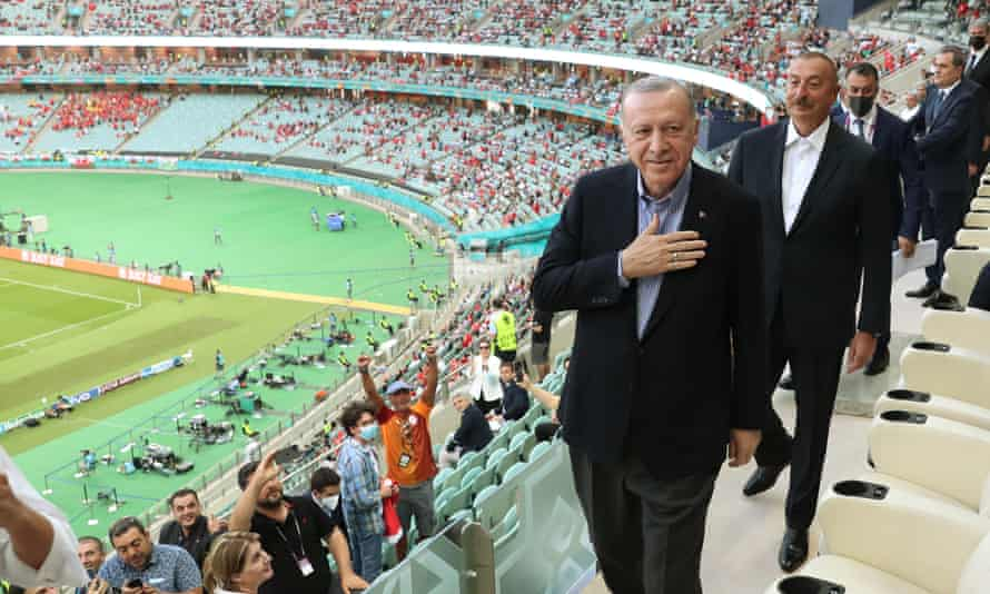 Turkey's president, Recep Tayyip Erdogan, and Azerbaijan's president, Ilham Aliyev, arrive to watch the game
