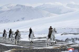 Kim Jong Un with his wife Ri Sol Ju ride on white horse to Mount Paektu