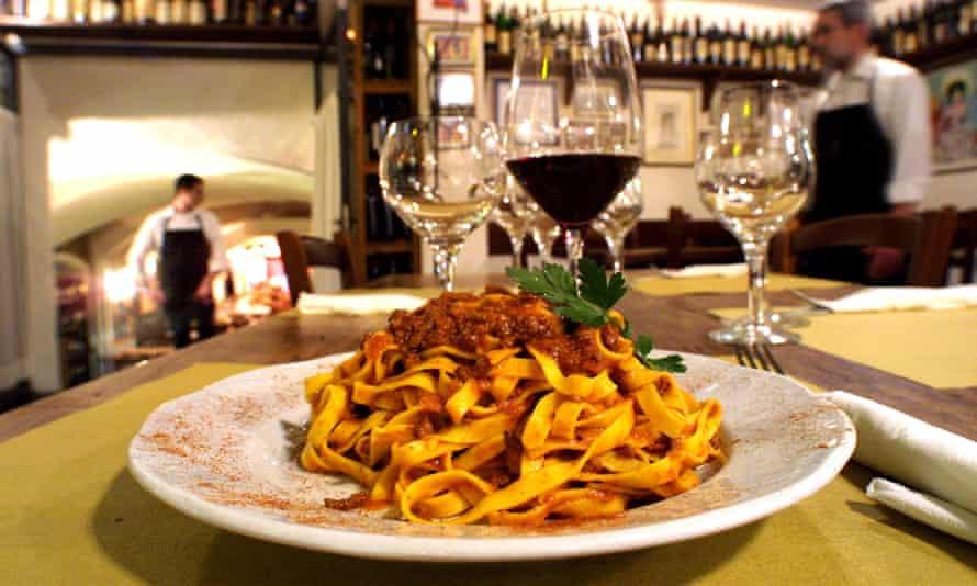 Close up of a plate of tagliatelle al ragu at a restaurant in the Emilia-Romagna region of Italy.