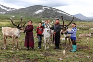 A family poses proudly with some of their reindeer. From left to right, Bolorma, Ulziitsetseg, Tuvshinbayar, Ulziichimig, Narahuu and the oldest daughter, Ulziisaihan