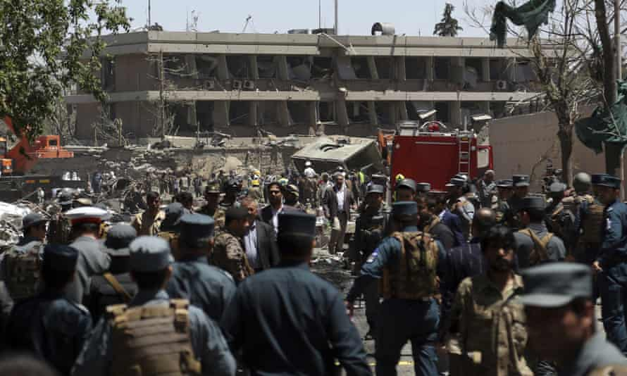 Security forces inspect the site of a suicide attack near the German embassy in Kabul