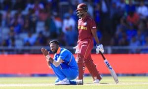 India's Hardik Pandya (left) celebrates taking the wicket of West Indies' Sunil Ambris by LBW.