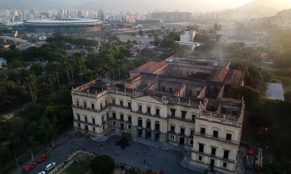 Rio de Janeiro's burned out National Museum, one of Brazil's oldest, with the Maracanã stadium in the background.