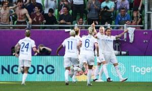 Olympique Lyonnais' Dzsenifer Marozsan celebrates scoring their first goal with teammates.