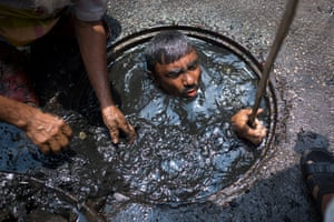 A sewer cleaner of in Dhaka, Bangladesh.