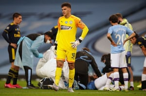 Ederson reacts as medics tend to Garcia as he lays injured.