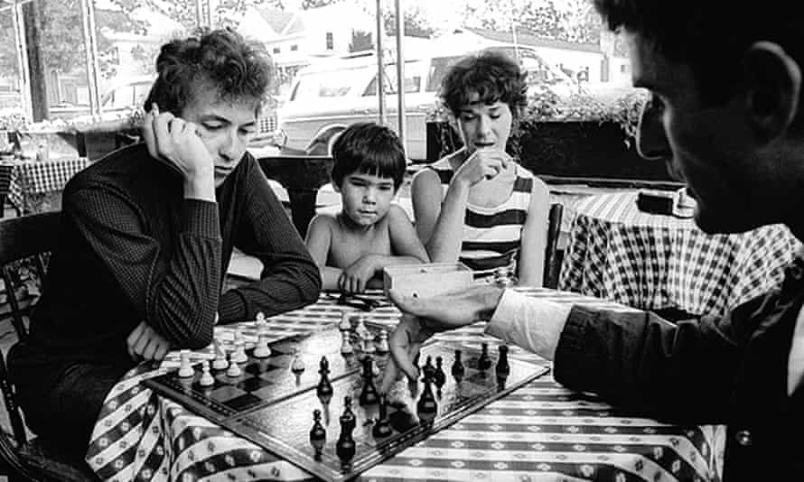 Bob Dylan plays chess with Victor Maymudes at Bernard's Cafe Espresso, a favorite hangout spot in Woodstock, 1964
