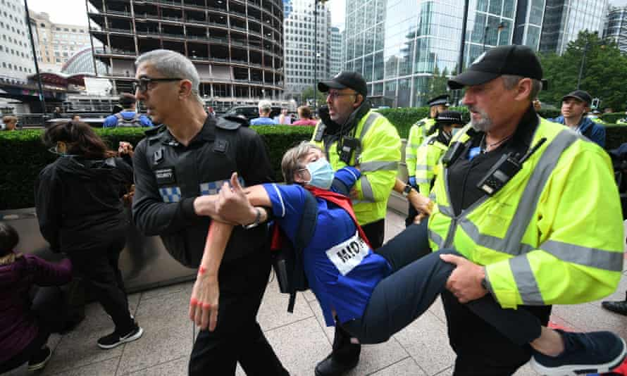A protester is carried away by security guards