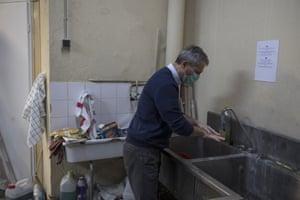 Serge Bruna washes his hands