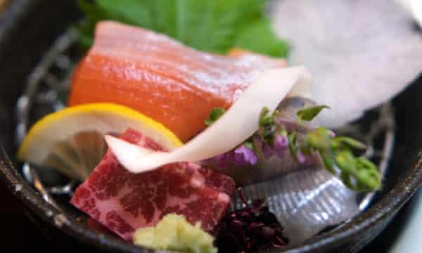 Fish sashimi and horsemeat at a ryokan, or Japanese inn.