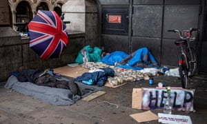 A makeshift home of cardboard mattresses and lightweight blankets next to Westminster station