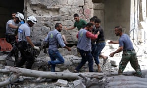 People search for victims of an air attack in Aleppo, Syria.