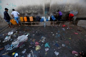 People collect drinking water from a public tap, amid a cholera outbreak, in Sanaa, Yemen, June 29, 2017.