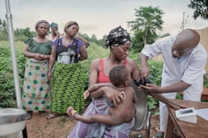 Mother being medically assessed in Benin