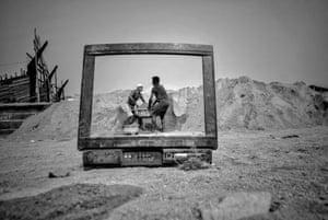 Workers viewed through broken tv