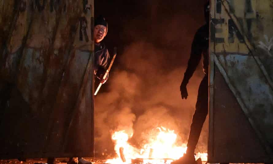 Fires at the Peace Gate in Belfast on 7 April after youths attacked police and petrol-bombed a bus.