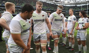 Saracens walk off the pitch after their Champions Cup defeat to Leinster.