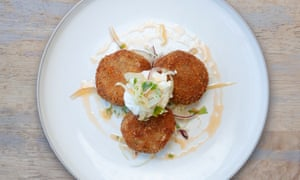 Crab and chilli fishcakes on a round white plate