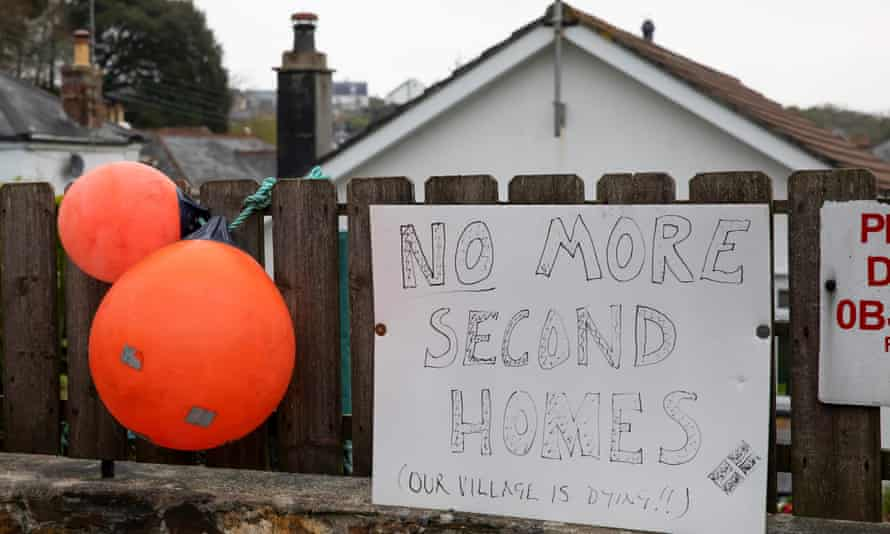 A sign saying 'No more second homes' is seen in St Agnes, Cornwall.
