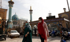 Iranian women wearing face masks walk past next to the Saleh shrine in Tehran, Iran, 26 October 2020.