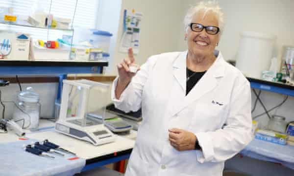Loretta Mayer, CEO of SensTech, holds up a test cup of the company's rat contraceptive formula.