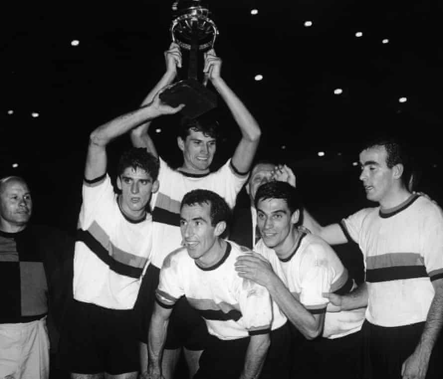 Armando Picchi, captain of Internazionale, celebrates his team's win in the World Club Championship at the Santiago Bernabeu Stadium in Madrid, 26th September 1964. Holding the cup is teammate Giacinto Facchetti.