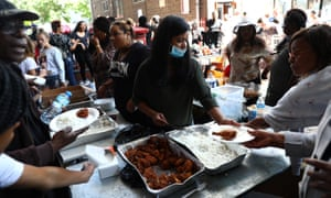 Volunteers hand out food on Thursday to people affected by the Grenfell Tower fire.