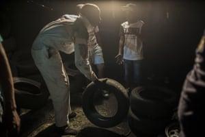 Legendary spinner Ngamshi checking tyres