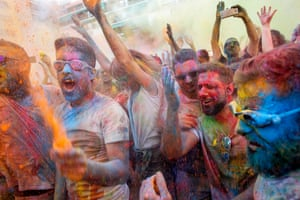 People take part in the fourth edition of the Monsoon Holi Madrid party at the multicultural district of Lavapies. Participants were sprayed with thousands of liters of water, tinted with 600 kgs of colored powder, Madrid, Spain