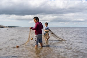 """Dear Newtok is an audio/visual advice """"column"""" produced by residents of the Yukon-Kuskokwim delta in south-west Alaska, one of the first regions in the US to experience forced relocation due to the climate crisis. Drake Charles and Jeffrey Charles Jr catch fish along the banks of the Baird inlet in Mertarvik, Alaska, in July 2020"""