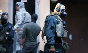 Police officers wearing protective clothes during the operation in Cologne.