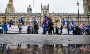 Anti-Brexit campaigners outside the Houses of Parliament in London