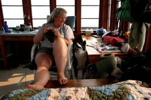Duffey knits while taking a break from her duties at the fire lookout. Even after spotting about 50 fires throughout her career, she gets a jolt when she spots a fresh one. 'My heart starts racing, and I get a little short of breath,' she says.