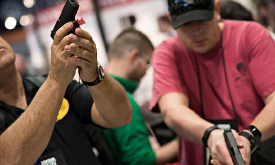 Gun enthusiasts try out Glock weapons at the National Rifle Association annual meeting in Nashville in 2015.