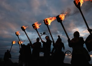 Viking re-enactors line up as they prepare to set fire to a 25ft-tall wicker wolf ahead of the reopening of the Jorvik viking centre in York.