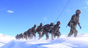 Ngari, China Frontier soldiers march in snow in Tibet Autonomous Region of China.